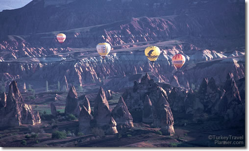 Hot Air Balloons Flying over the moonscape of Cappadocia, Turkey